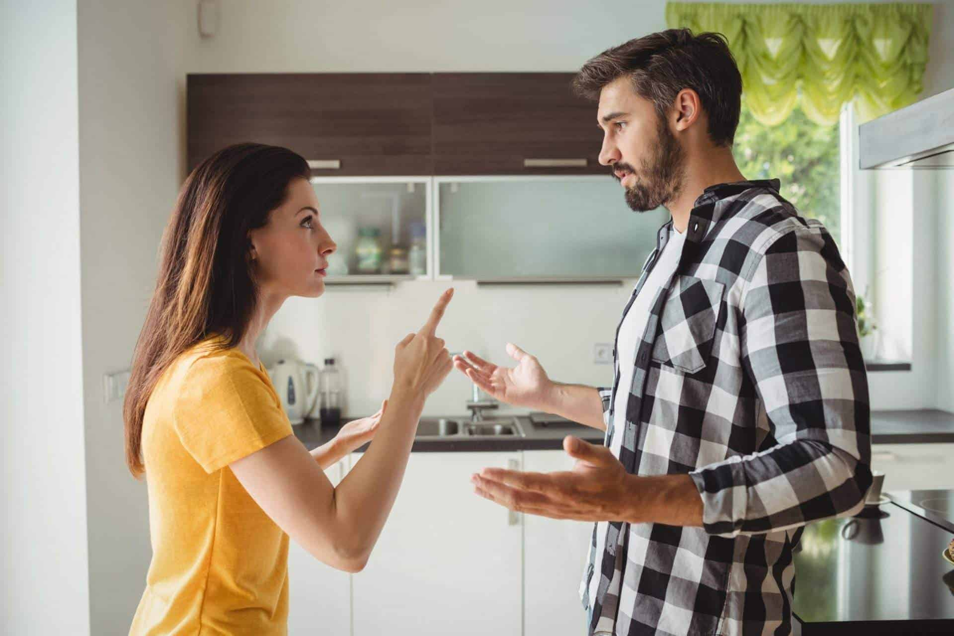 Canva-Couple-having-argument-in-kitchen